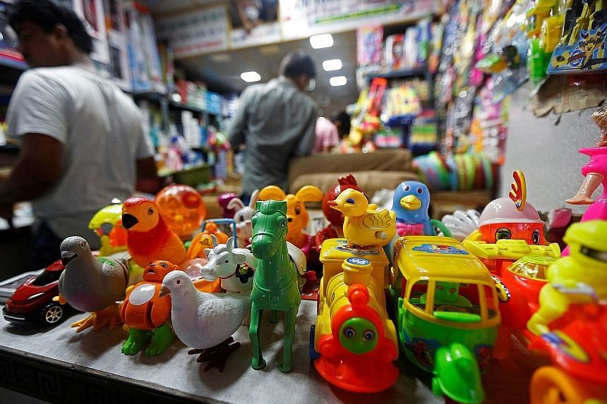 A shop selling made-in-China toys at a market in India's Kolkata. For India's toy retailers, who import everything from toy cars to musical phones and even robots from China, new requirements on quality set by New Delhi meant supply disruptions befor