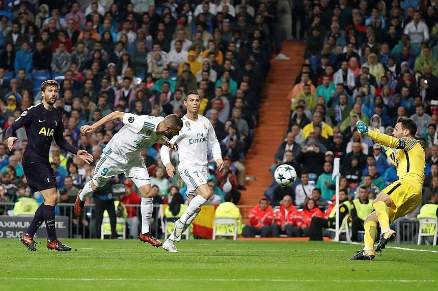 Real Madrid striker Karim Benzema (No. 9) missing a gilt-edged chance in the second half with Spurs goalkeeper Hugo Lloris pulling off a splendid save. Both sides will lock horns again on Nov 1 at Wembley.