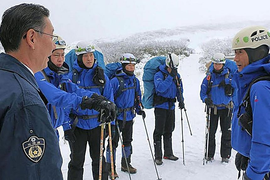 About 130 personnel from the Hokkaido police force's mountain rescue team (top) and from the military Ground Self-Defence Force (above) were reported to be involved in the successful search operation. The hikers were found 22 hours after they made a