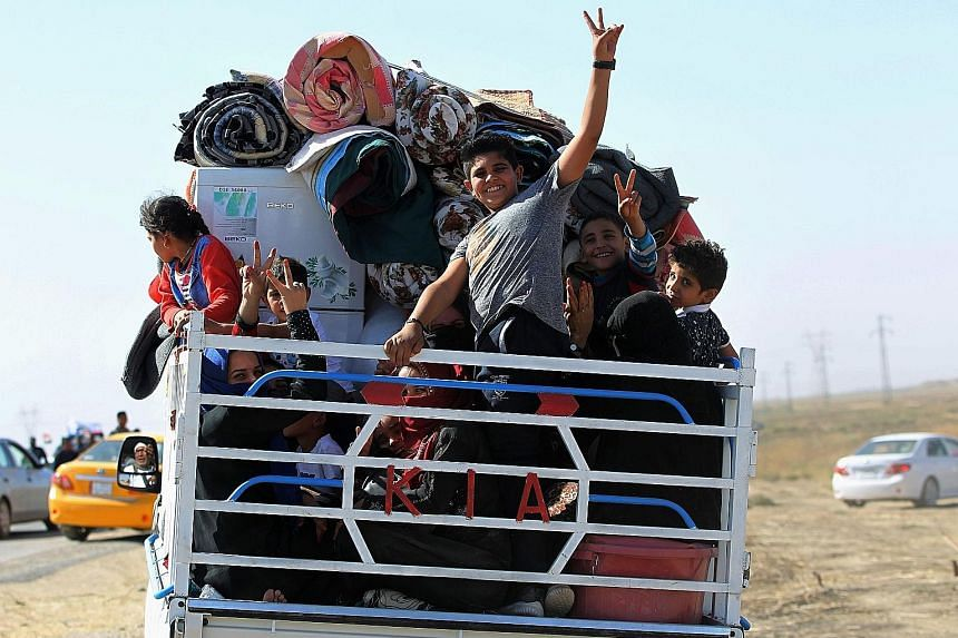 Displaced Iraqis, who fled from Hawija in 2014 to Kirkuk, making their return to Hawija yesterday, after the town was retaken by government forces. Prime Minister Haider al-Abadi said on Tuesday that the Sept 25 vote for Kurdish independence was now