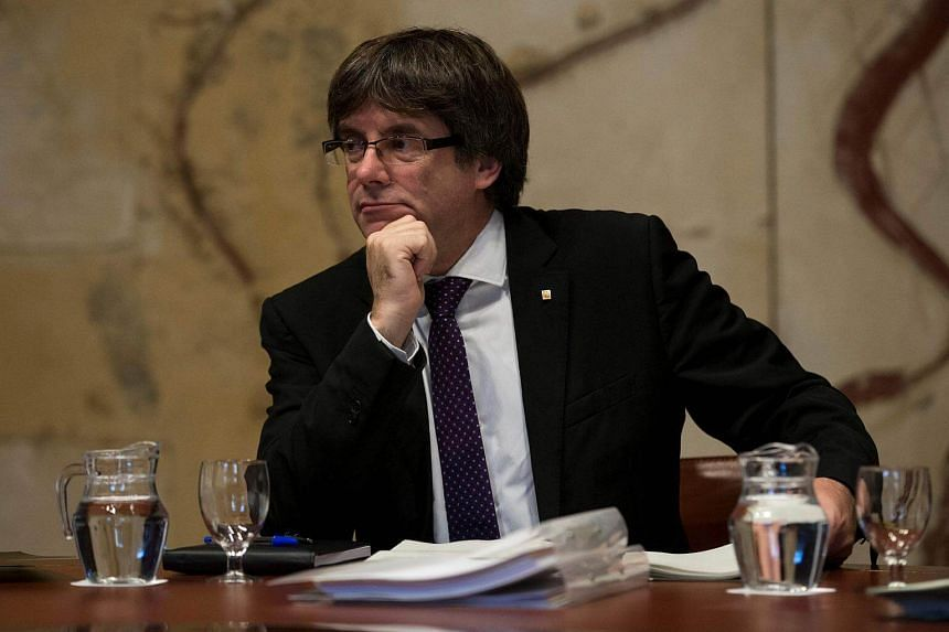 Catalonia's separatist leader Carles Puigdemont must abandon his bid for independence from Spain on Thursday (Oct 19) or face an unprecedented move by Madrid to seek a suspension of his region's autonomy.
