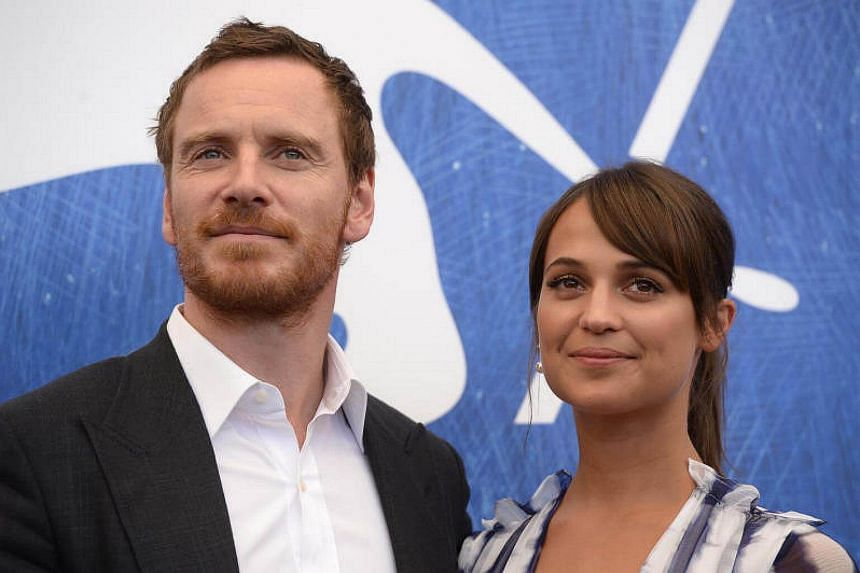 British actor Michael Fassbender and Swedish actress Alicia Vikander pose during a photocall of the movie The Light Between Oceans.