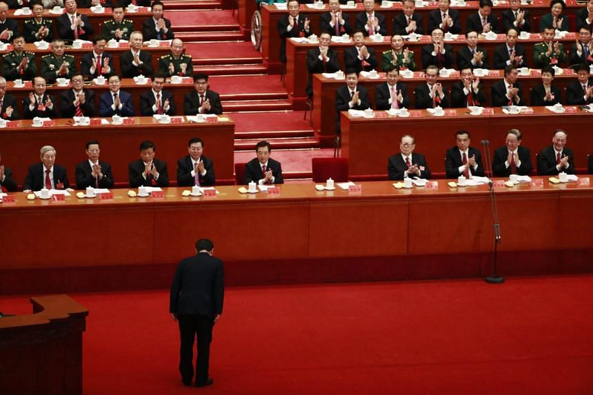 Chinese President Xi Jinping (bottom) bows to delegates after his speech during the opening ceremony of the 19th National Congress of the Communist Party of China (CPC) at the Great Hall of the People (GHOP) in Beijing.