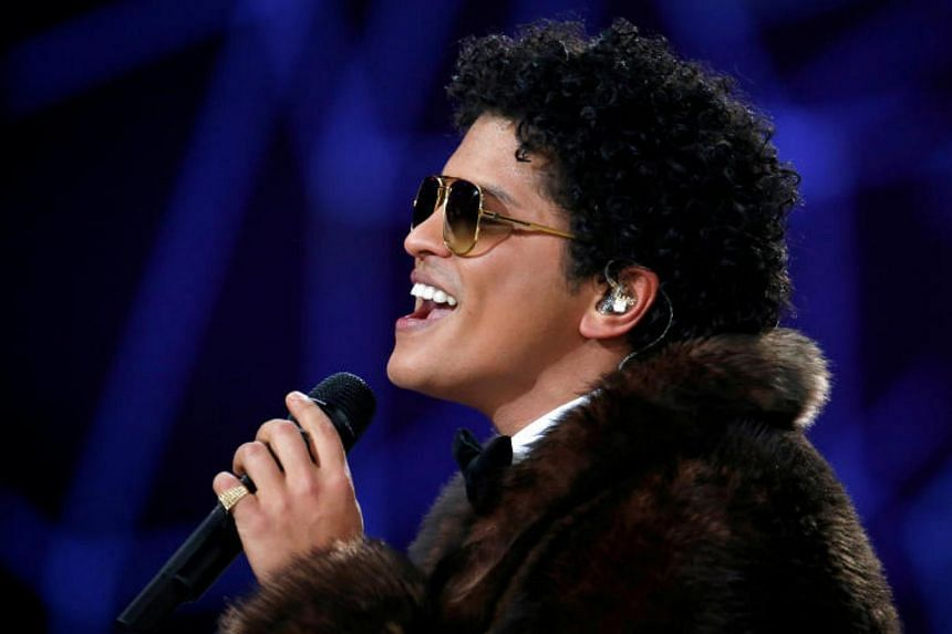 Musician Bruno Mars performs during the 2016 Victoria's Secret Fashion Show at the Grand Palais in Paris, Nov 30, 2016.