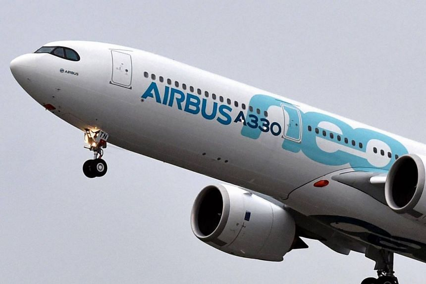 A new Airbus A330neo makes its first flight over Colomiers, after taking off from the Toulouse-Blagnac airport on Oct 19, 2017.