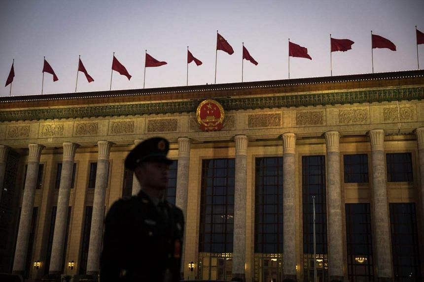 A member of China's People's Liberation Army (PLA) stands guard in front of the Great Hall of the People (GHOP) during delegation discussions of the 19th National Congress of the Communist Party of China (CPC) in Beijing, China, on Oct 19, 2017.