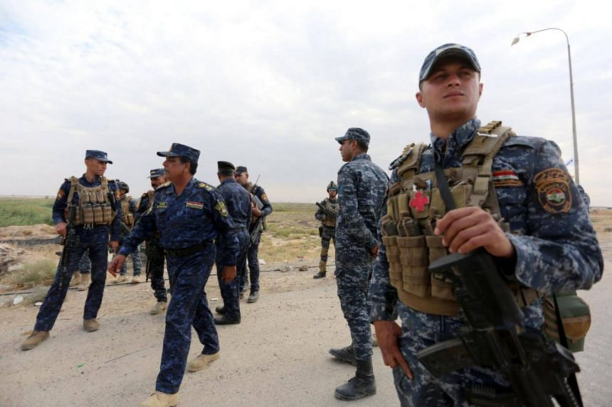 Iraqi federal police forces take up position in Rashad town, north of Iraq, on Oct 13, 2017.