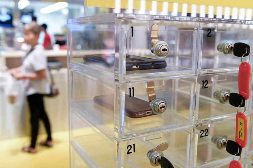 McDonald's Singapore has set up a mobile phone locker at its Marine Cove outlet at East Coast Park, so customers can stow away their devices during mealtime.