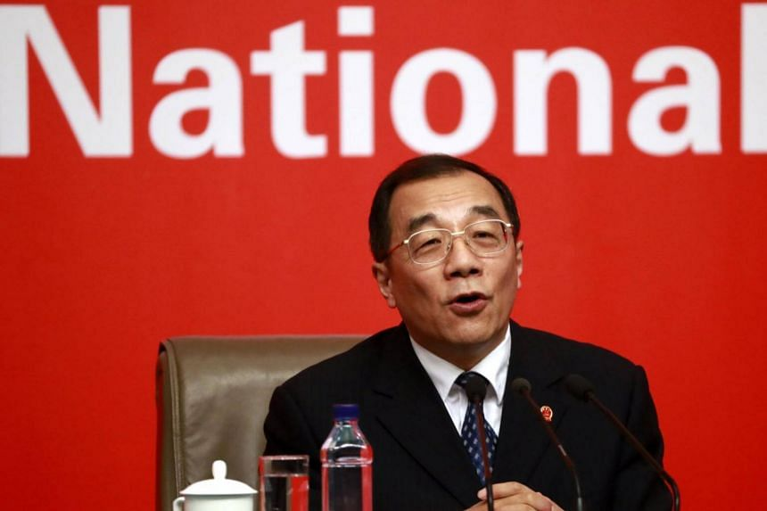 China's Minister of Supervision, and Chief of the National Bureau of Corruption Prevention, Yang Xiaodu speaks during a press conference on the sidelines of the 19th National Congress of the Communist Party of China (CPC) in Beijing, China, on Oct 19