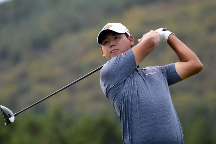 Kim Si Woo of South Korea teeing off on the ninth hole during the first round of the CJ Cup, the PGA Tour's first foray into South Korea, at Nine Bridges in Jeju Island on Oct 19, 2017.