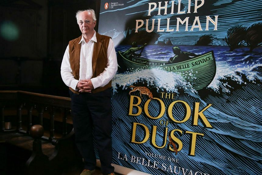British author Philip Pullman poses with his new book La Belle Sauvage: The Book of Dust Volume One during a photo call at Convocation House, in Oxford.