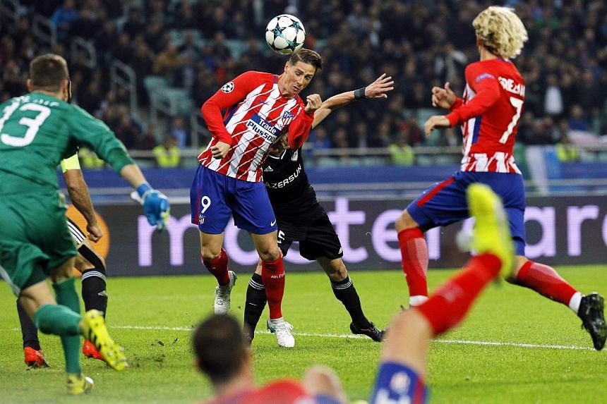 Atletico Madrid's Fernando Torres (cerntre) in action during the Uefa Champions League group C football match between Qarabag FK and Atletico Madrid.