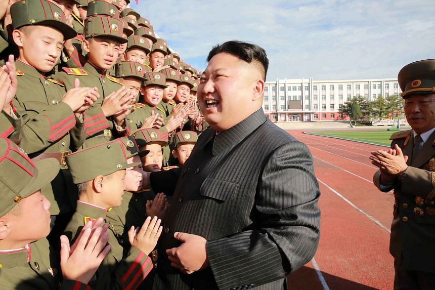 North Korean leader Kim Jong-Un (centre) photographed with students and teachers of Mangyongdae Revolutionary School in Pyongyang.