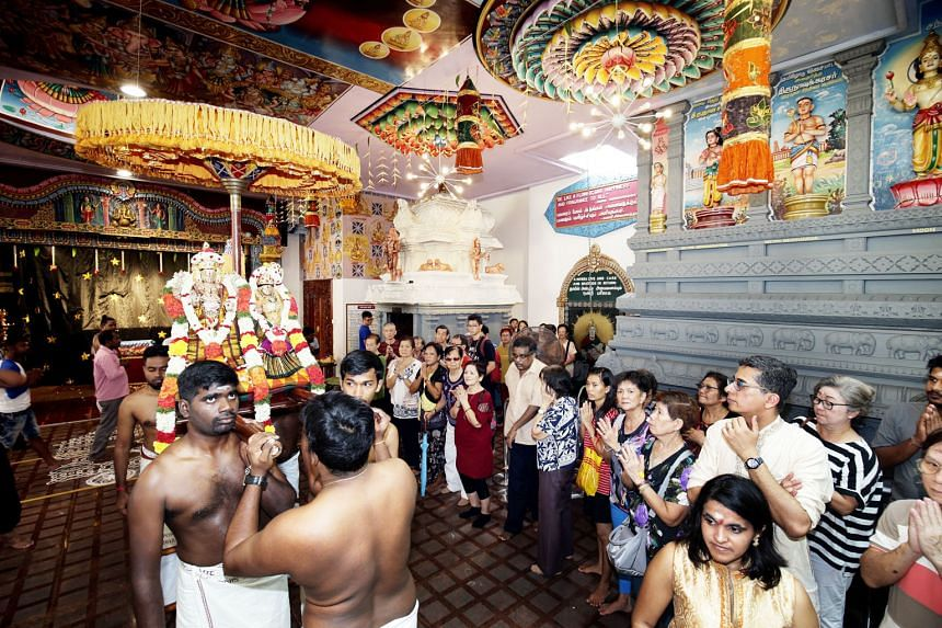Residents of various faiths and races from the South East District celebrating with devotees at the Sri Senpaga Vinayagar Temple in Ceylon Road. A guided tour of the 140-year-old Sri Senpaga Vinayagar Temple was held for the volunteers and residents