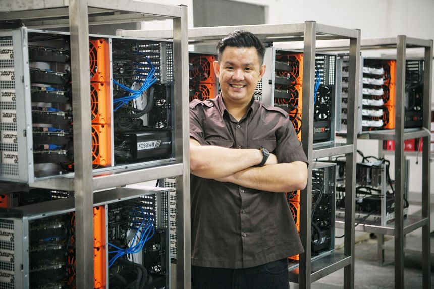 """Mr Lim Hong Zhuang, seen here at a Chi-X (pronounced """"kai axe"""") data centre, says people now look more at how cryptocurrency technology can be developed, rather than just the idea of profiting from digital currencies. His firm builds data centres to"""