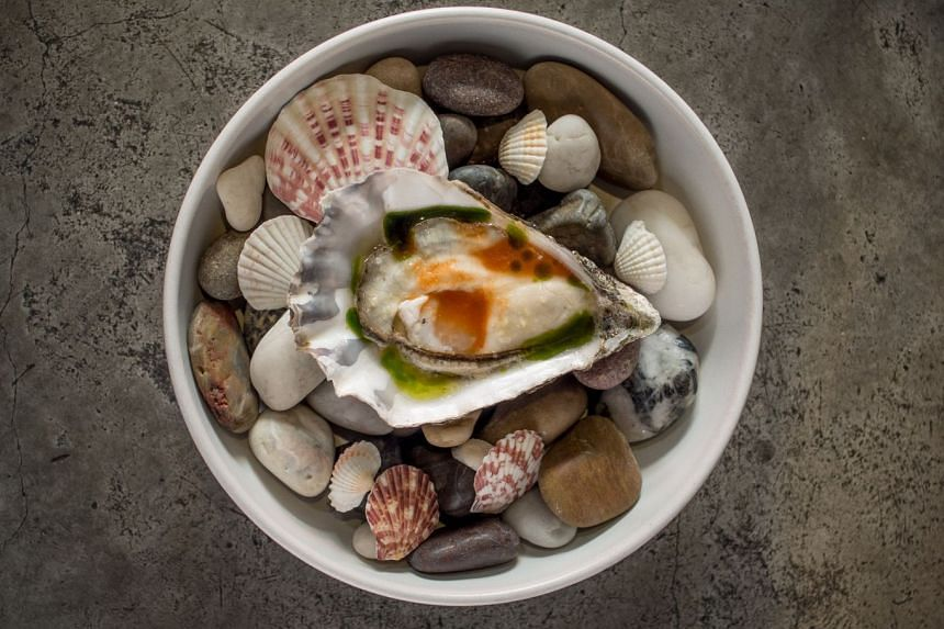 Creamy Irish oyster with a lemon-ginger dressing, chive oil, and a spoonful fiery gochujang at Meta.