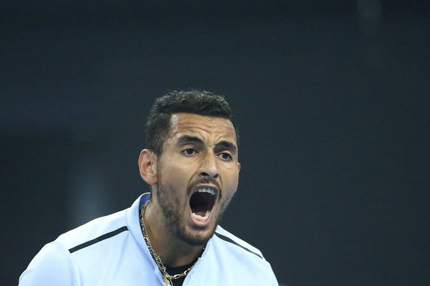 Kyrgios reacts during his men's singles final match against Rafael Nadal at the China Open.