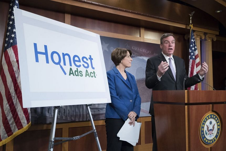 Mark Warner (right) and Amy Klobuchar introduce the Honest Ads Act at a news conference.