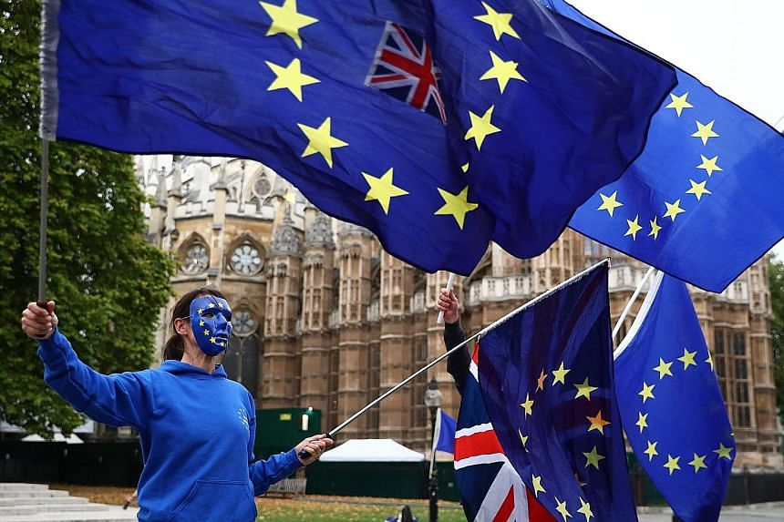 A pro-EU protest outside the Houses of Parliament in London on Tuesday. Some observers in the British capital are now arguing that, instead of seeking to avert it, an actual breakdown in the talks may potentially be the only way out of the current im