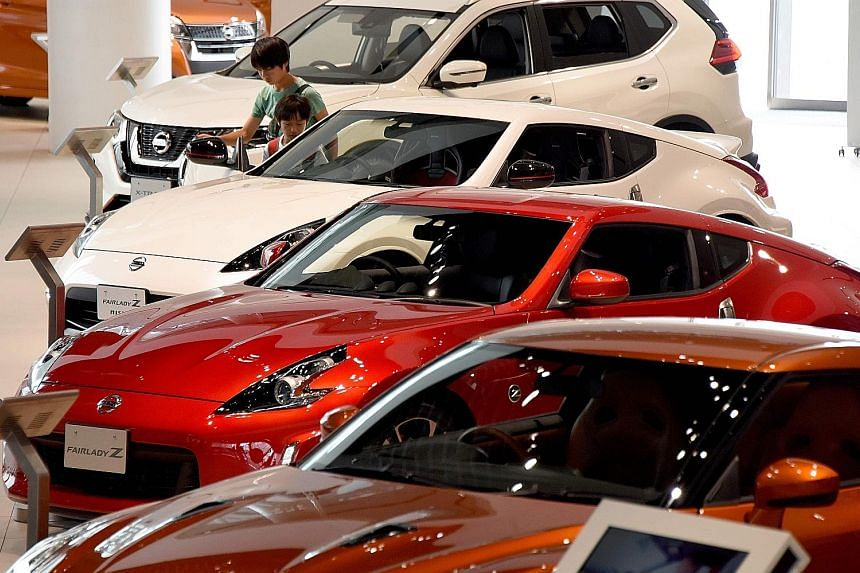 Nissan cars at a showroom in Yokohama. The carmaker's latest announcement comes after it had admitted earlier that staff without proper authorisation had conducted final inspections on some vehicles intended for the domestic market before they were s