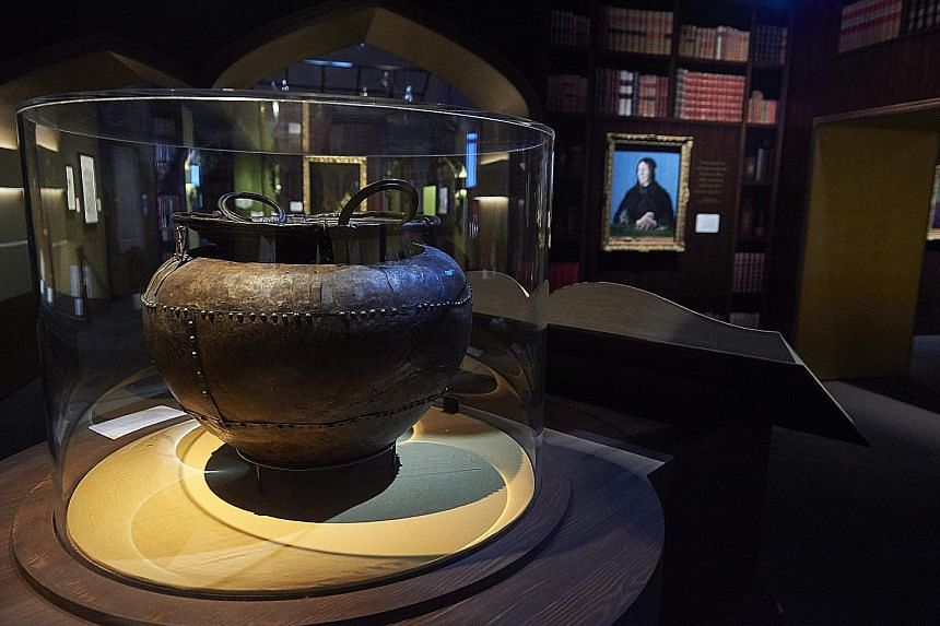 Held at the British Library in London, the Harry Potter: A History Of Magic exhibition features items such as books (top), a painting of Professor Dumbledore (above) and the Battersea Cauldron (right). A drawing of Harry Potter and his broomstick on