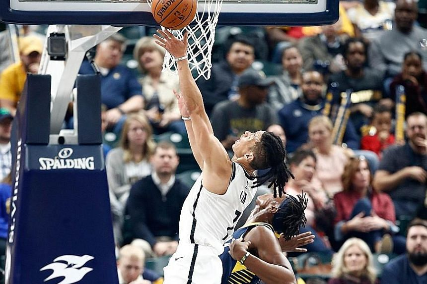 Left: Brooklyn Nets guard Jeremy Lin going for a lay-up at the Indiana Pacers on Wednesday. The Asian-American star suffered a serious non-contact injury while driving to the basket. pick last year, but had to sit out last season with a broken foot.