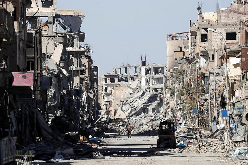 The ruins near the Al-Naim traffic circle in Raqqa on Wednesday. The Syrian city was once home to tens of thousands of people, but there are now no civilians in sight, with buildings reduced to piles of concrete cinder blocks, pipes and wires.
