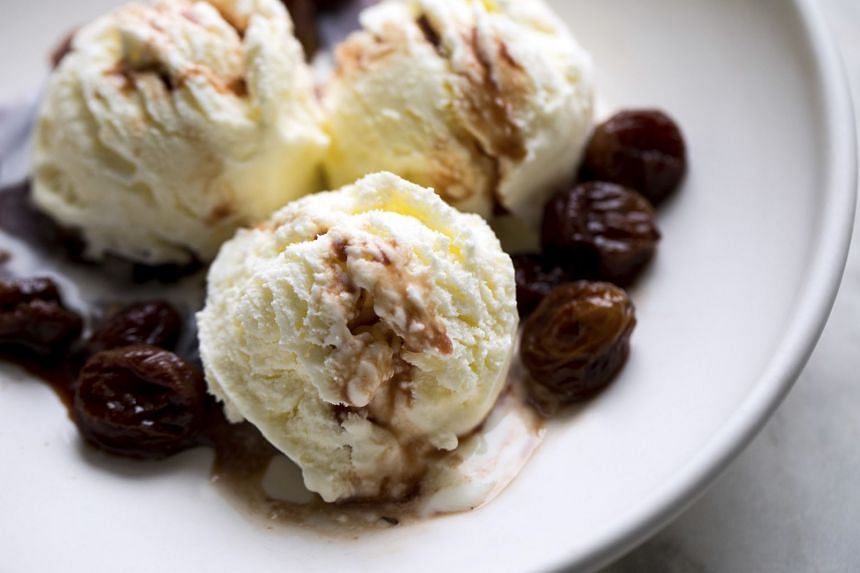Grapes caramelised in honey and wine make a sweet-tart topping for yogurt ice cream. PHOTO: NYTIMES
