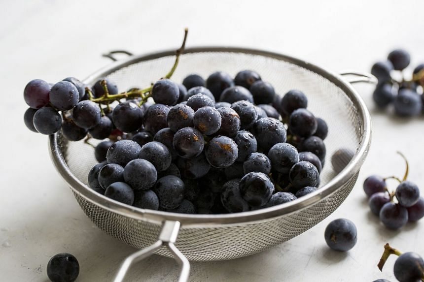 Black grapes, such as Concords, have dark purple-blue skin and a powdery white film called 'bloom'. PHOTO: NYTIMES
