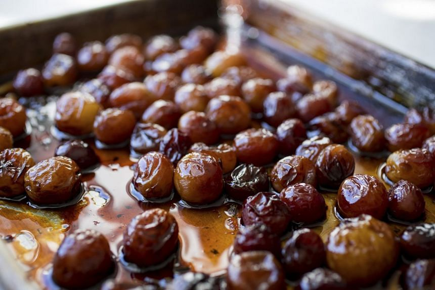 Roasting grapes in wine brings out all the flavours of the fruit. PHOTO: NYTIMES