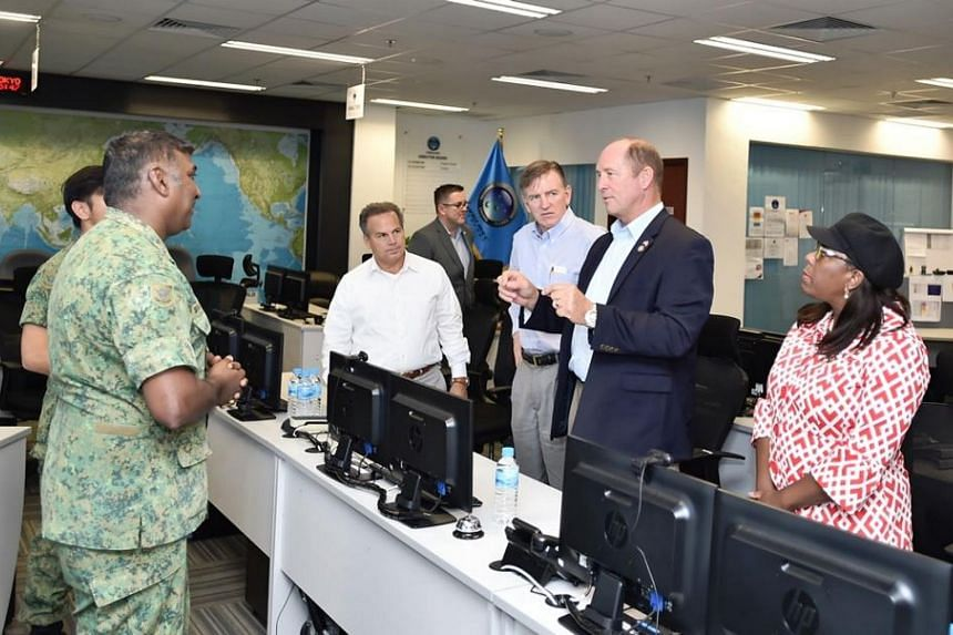 The US congressional delegation interacting with Deputy Director of the Changi Regional Humanitarian Assistance and Disaster Relief (HADR) Coordination Centre (RHCC) Lieutenant Colonel Siva Balan (left) during a brief at the Changi RHCC, as part of t