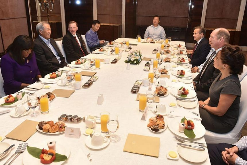 Minister for Defence Ng Eng Hen (second from left) hosting the US congressional delegation, led by US Chairman of the House Foreign Affairs Subcommittee on Asia and the Pacific Ted Yoho (second from right), to breakfast on Friday (Oct 20).