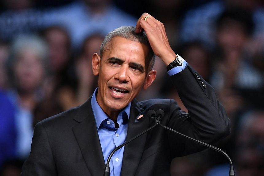 Former US President Barack Obama speaks during a campaign rally for Democratic Gubernatorial Candidate Ralph Northam (unseen) in Richmond, Virginia on Oct 19, 2017.