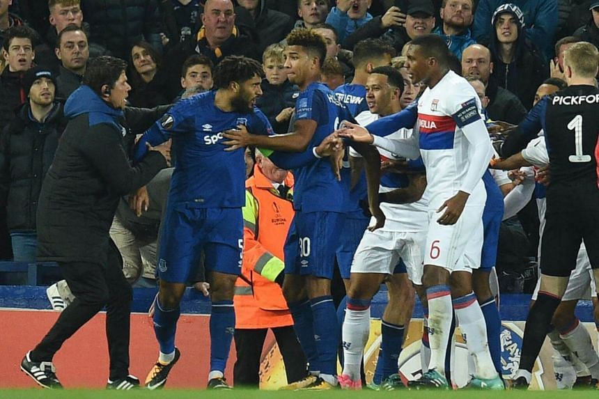 Everton's English-born Welsh defender Ashley Williams (second from left) is kept apart as players clash during the UEFA Europa League Group E match between Everton and Lyon at Goodison Park, in Liverpool on Oct 19, 2017.