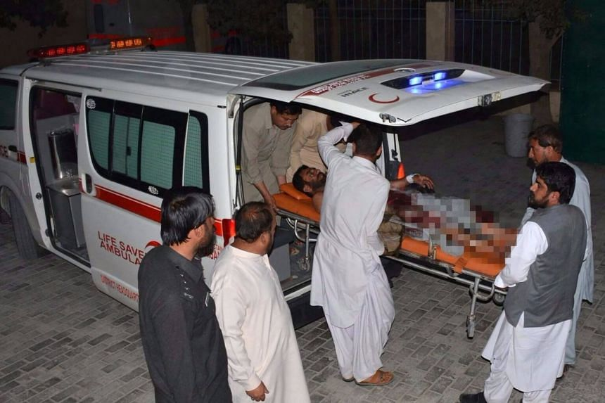 Pakistani men shift an injured victim into a hospital in Quetta on Oct 19, 2017.