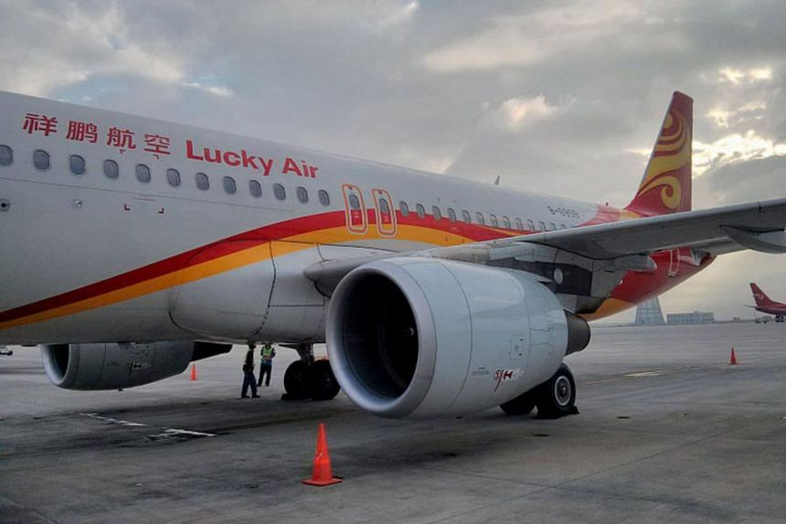 Fellow passengers reported that coins were tossed at the engine of a Lucky Air jet during boarding, and ground crew later found coins lying on the tarmac next to the plane.