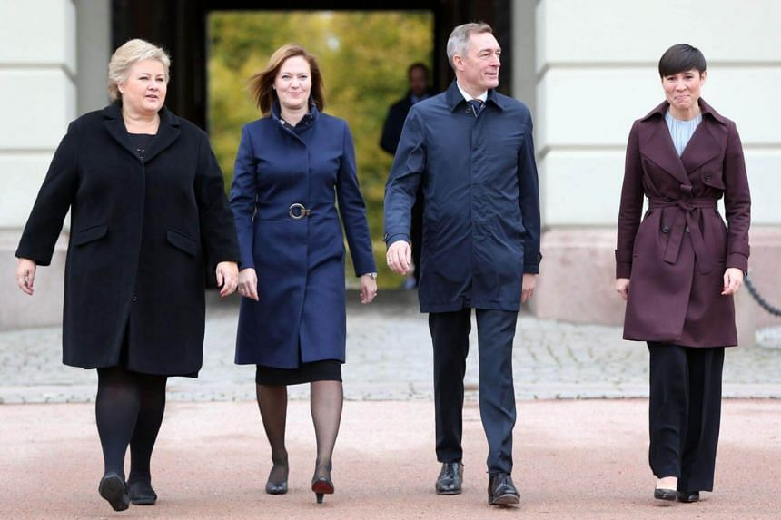(From left) Norwegian Prime Minister Erna Solberg walks with newly-appointed Minister for EEA and EU Affairs, Marit Berger Rosland; Minister of Defence Frank Bakke-Jensen and Foreign Affairs Minister Ine Eriksen Soreide on Oct 20, 2017 outside the No