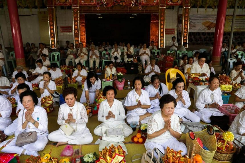 Thai devotees pray at a temple to mark the eve of the vegetarian festival in Bangkok's Chinatown, Thailand on Oct 19, 2017.