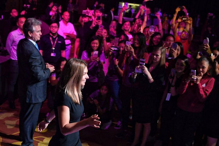 Simona Halep waves to fans at the WTA Finals singles draw ceremony on Oct 20, 2017.