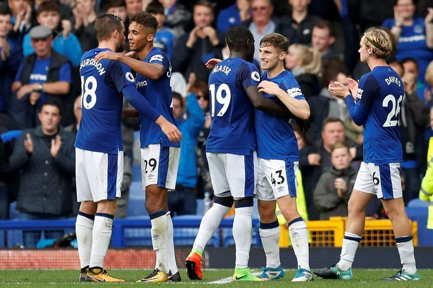 Everton players celebrate after a match against Bournemouth.