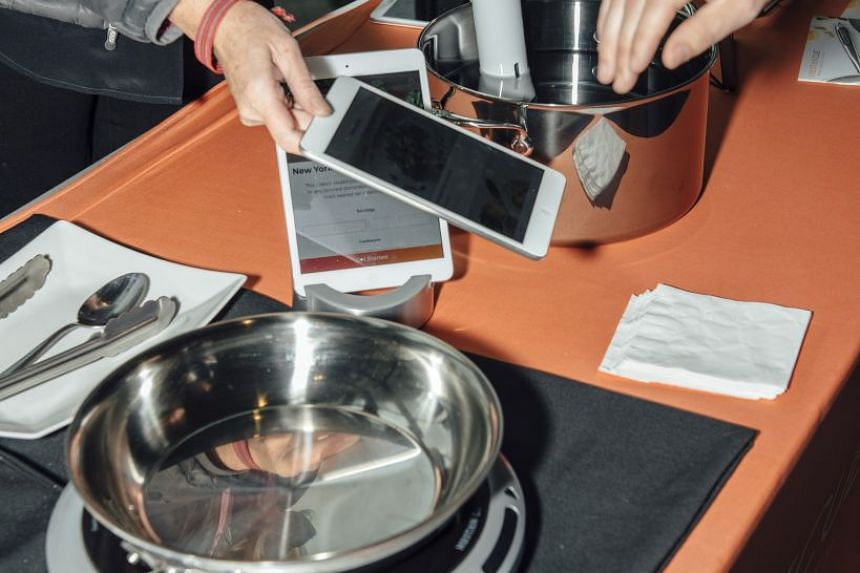 The Hestan Cue cookware system, on display at the Smart Kitchen Summit in Seattle. PHOTO: NYTIMES