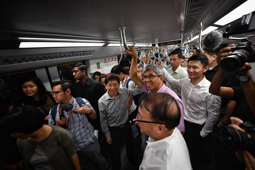 Ministers including Khaw Boon Wan (centre in grey) and Yaacob Ibrahim (centre in purple) taking the train from Expo to Tampines station during the opening of Downtown Line 3.