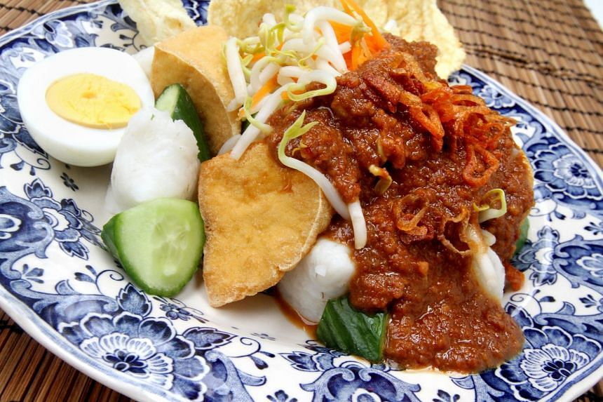 Ketupat and fried beancurd soak up the flavoursome peanut gravy in Kupat Tahu.