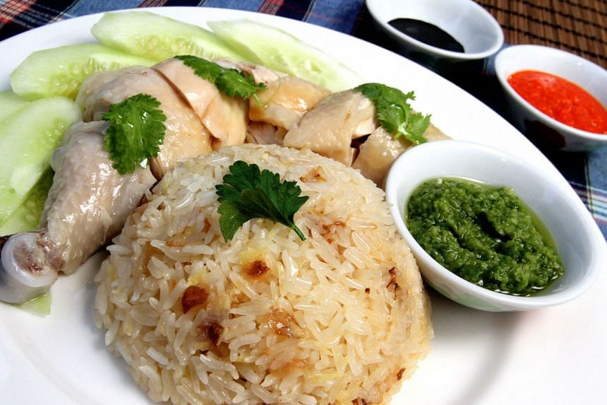 Dress up chicken rice with condiments and sauces.