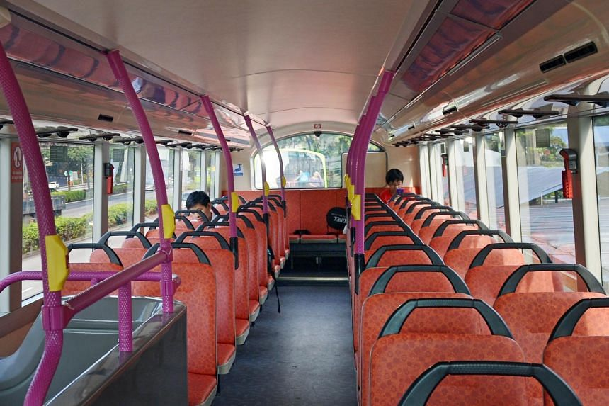 An almost-empty bus during off-peak travel hours.