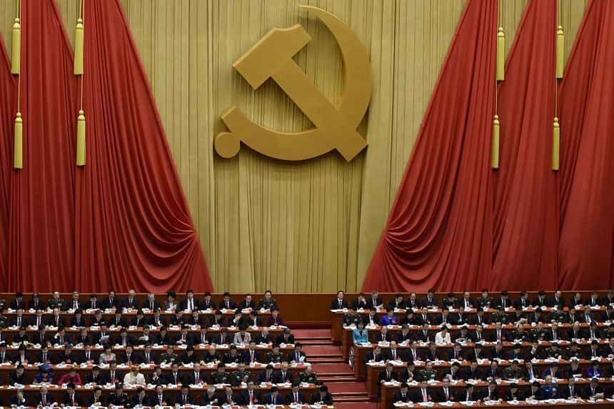 Delegates attending the opening session of the Chinese Communist Party's five-yearly Congress at the Great Hall of the People in Beijing.