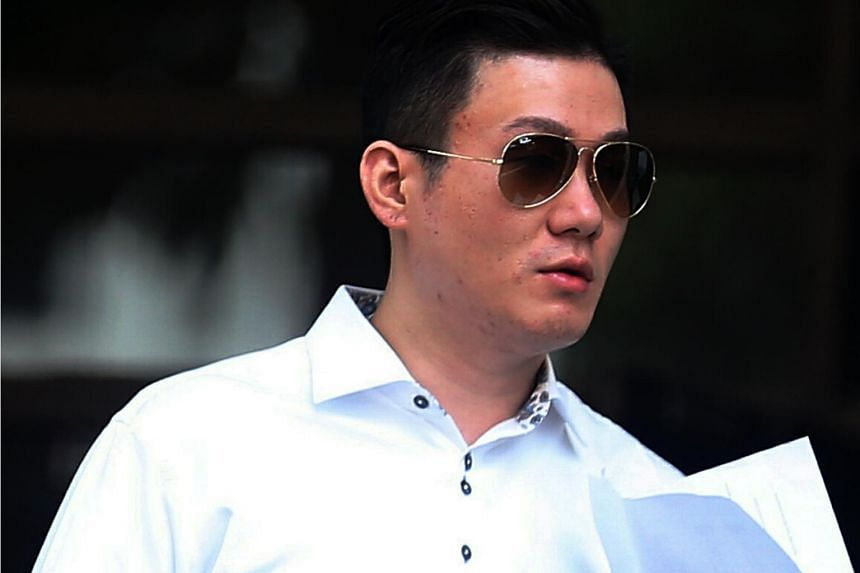 One of the two men charged is Clarence Lim Jun Yao. He faces charges for operating and using three sham companies to collect fees from more than 300 foreign jobseekers for jobs that did not exist.