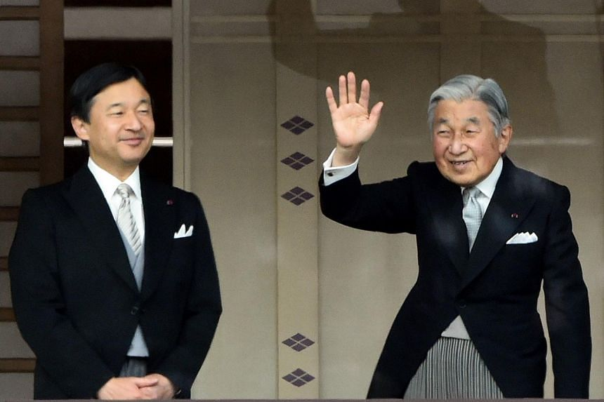 A file photo taken on Jan 2, 2015 shows Japan's Emperor Akihito (right) waving to well-wishers, as Crown Prince Naruhito looks on, during their new year greetings in Tokyo.