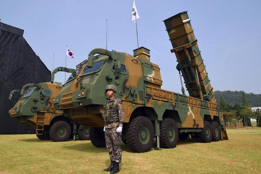 A file photo of a South Korean soldier standing by a Hyunmoo-2 ballistic missile system during a media day presentation of a commemoration event marking SouthKorea's Armed Forces Day, on Sept 25, 2017.