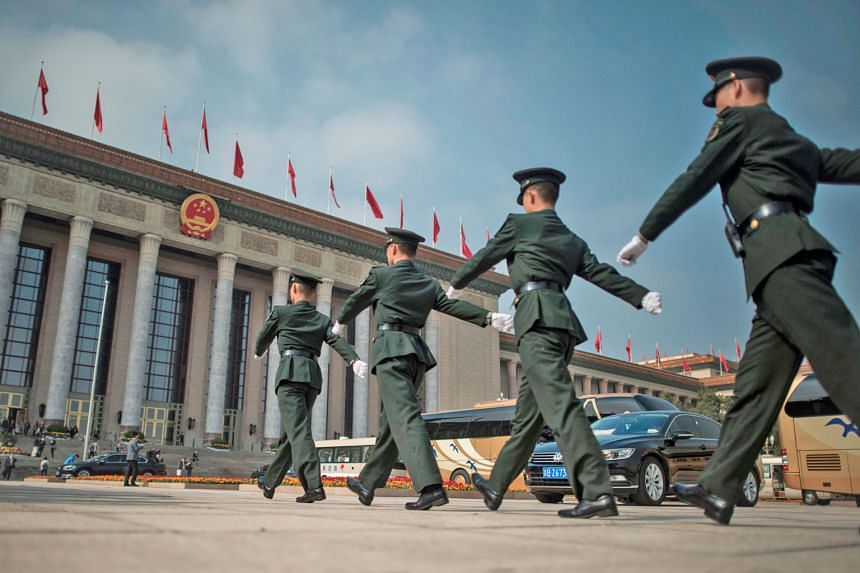 Paramilitary guards patrolling in front of the Great Hall of the People in Beijing yesterday, where the Chinese Communist Party's 19th Congress is being held. The congress, a week-long affair held twice in a decade, opened on Wednesday and will map